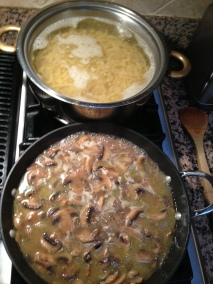 Pasta and mushrooms cooking