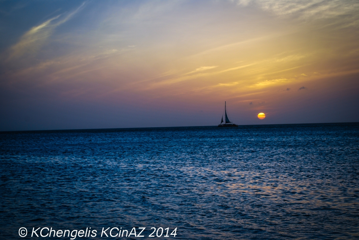 Lone Sail at Sunset